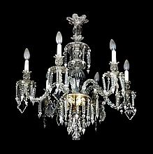 A ceiling lamp, a pair of wall lamps and a pair of candelabra, in carved crystal, circa 1930 Lamp of 6 lights