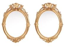 A pair of moulded and gold-plated wood and stucco Elizabethan mirrors, third quarter of the 19th Century