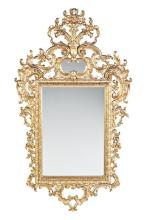 Spanish Rococo-style mirror in carved and mecca gilded wood, circa 1930-1940