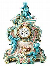 A Rococo style French table clock in Sèvres type porcelain from Paris, from the late 19th Century - first third of the 20th Century 58x