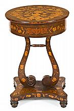 A Dutch style side table in mahogany with marquetry, from the 20th Century  78 cm high and 51 cm diam