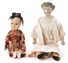 Porcelain doll, probably English, and Japanese papier mâché doll, circa 1880 and circa 1910