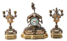 French garniture formed of a clock and a pair of candelabra in gilt calamine and Sèvres-type porcelain, late 19th Century