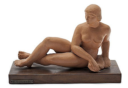 Rafael Solanic. Barcelona 1895-1990. Leaned female nude. Terra-cotta sculpture with wood stand. 16,5x23,7x10 cm