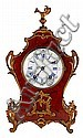 A Louis XV style gold-plated bronze and maple burl wood clock. Second half of the 19th century. Paris machinery. Check required in stan