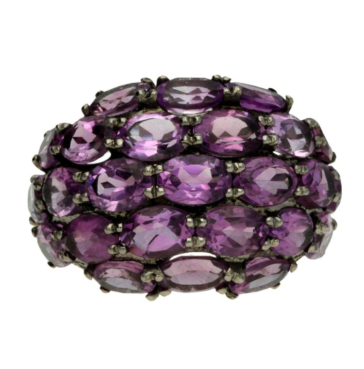 Amethysts bombée ring Black-rhodium silver, oval cut amethysts, 10.8 cts and round cut zircons, 1.03 cts. 8,5 gr