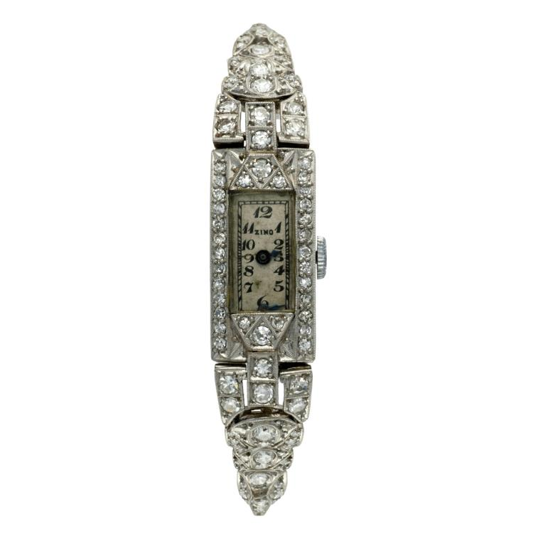 Art déco diamonds watch-jewel, circa 1925 Movement: Manual winding Platinum, rose, 16/16 and 8/8 cut diamonds, 1.93 cts. One hand is loose. Revision needed. 3,2 cmx1,2 cm 18,7 gr