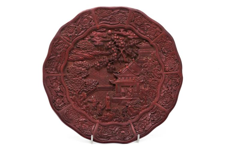 Chinese red lacquer dish with a landscape scene, late 19th Century Inscription on the back. 30.5 cm diam.