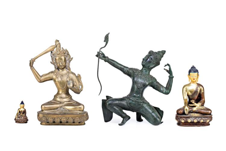 Burmese and Chinese school, 20th Century Buddhas and deity Four sculptures in bluing and gilt bronze 33x30x14.5 cm the biggest