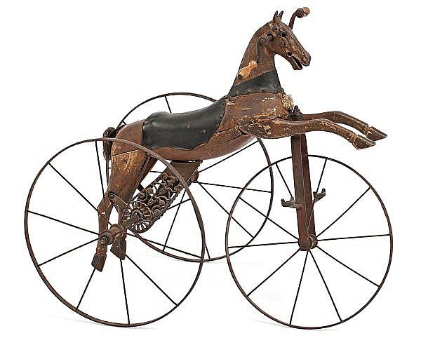 Caballo inglés de juguete en madera y hierro de finales del siglo XIX-principios del siglo XX