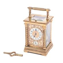 Carriage clock with the key and alarm
