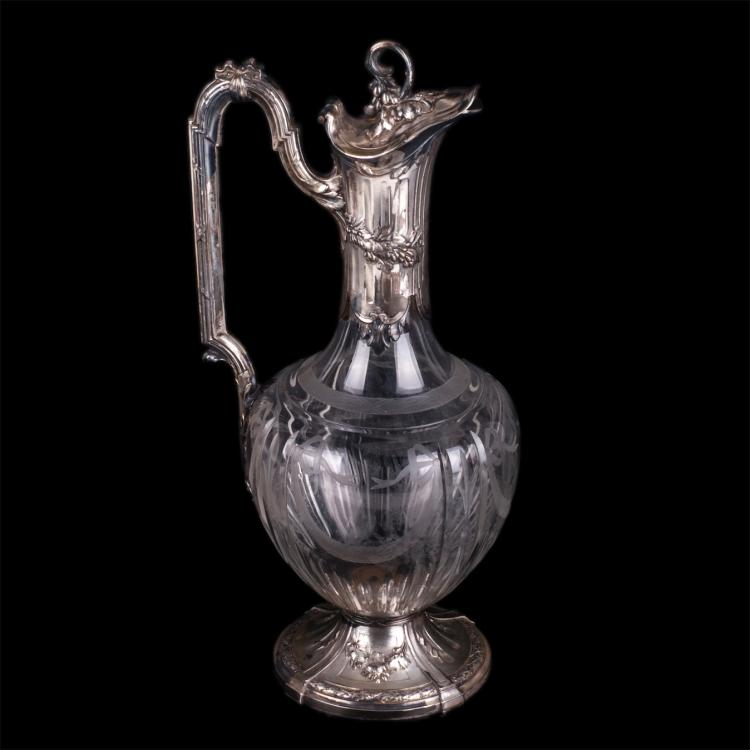 Antique jug with glass and silver encrusted