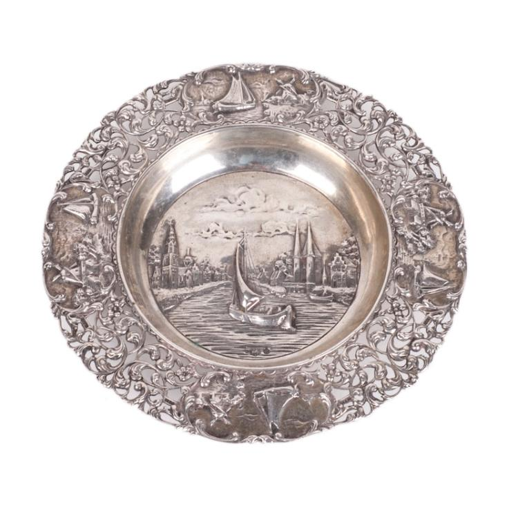 Silver dish with a view of Delft City Canal in Netherlands