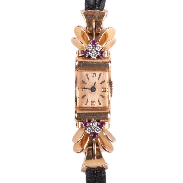 Gold 18K women's wristwatch.
