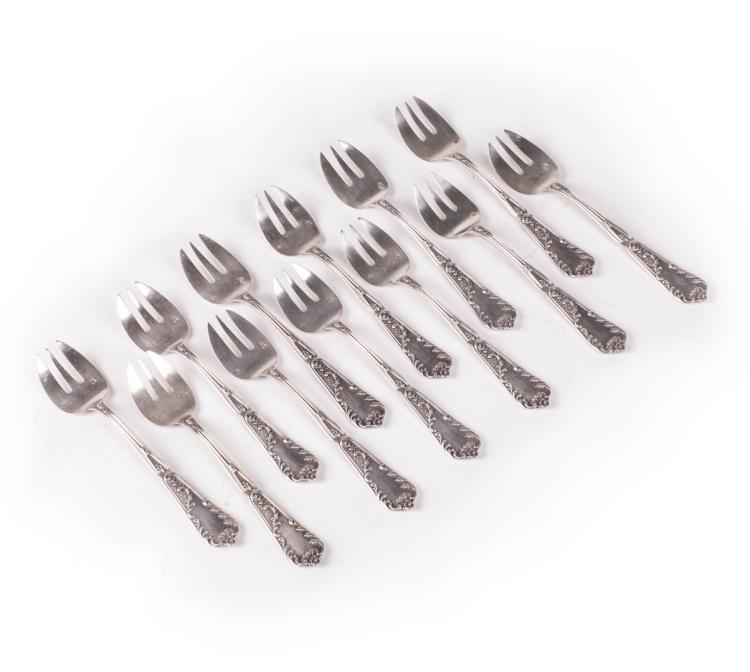 Antique set of 12 forks for oyster