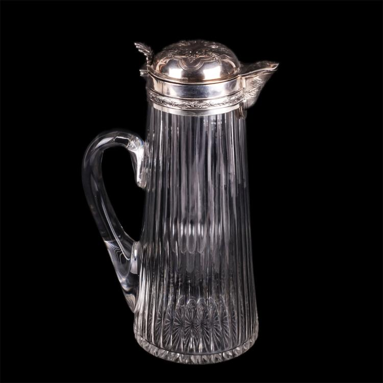 Antique silver jug with cooling element