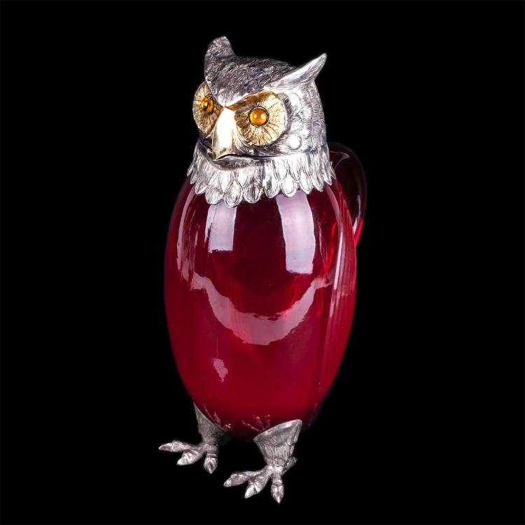 Antique jug in the shape of owl
