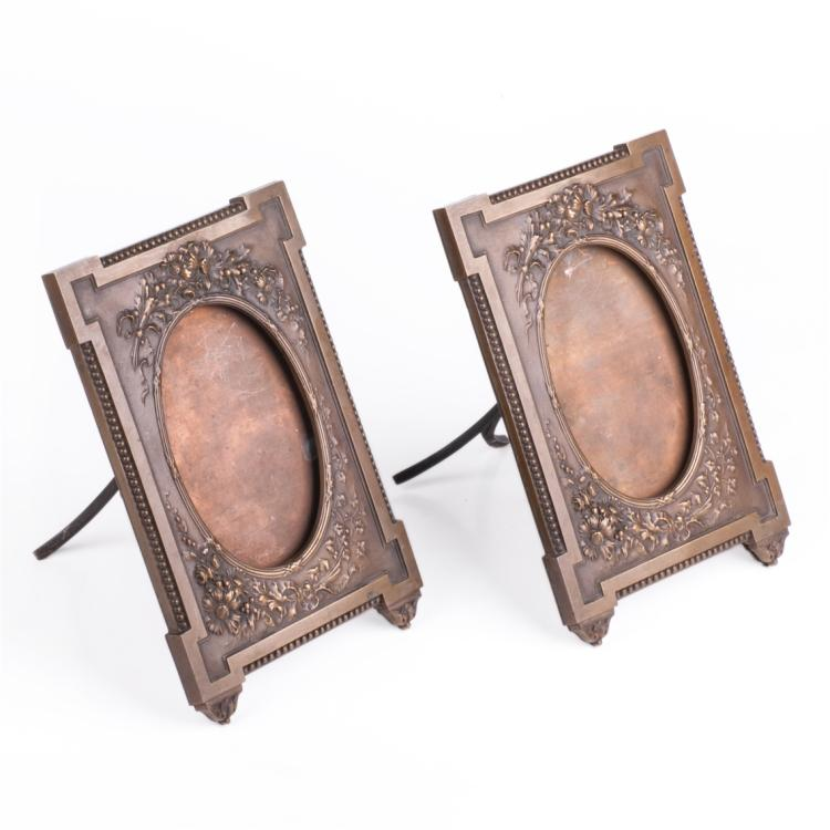 A pair of antique French bronze photo frames