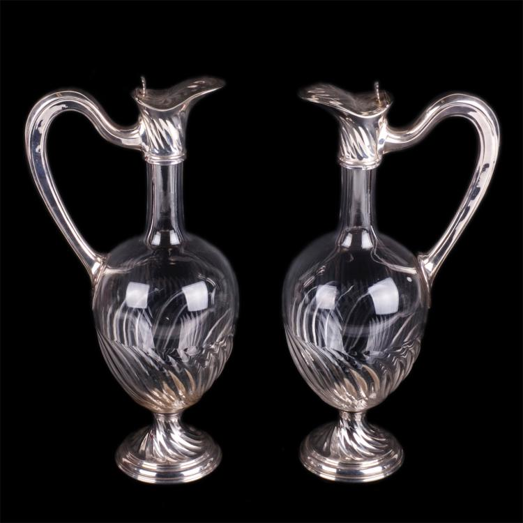 A pair of antique Art nouveau French silver decanters