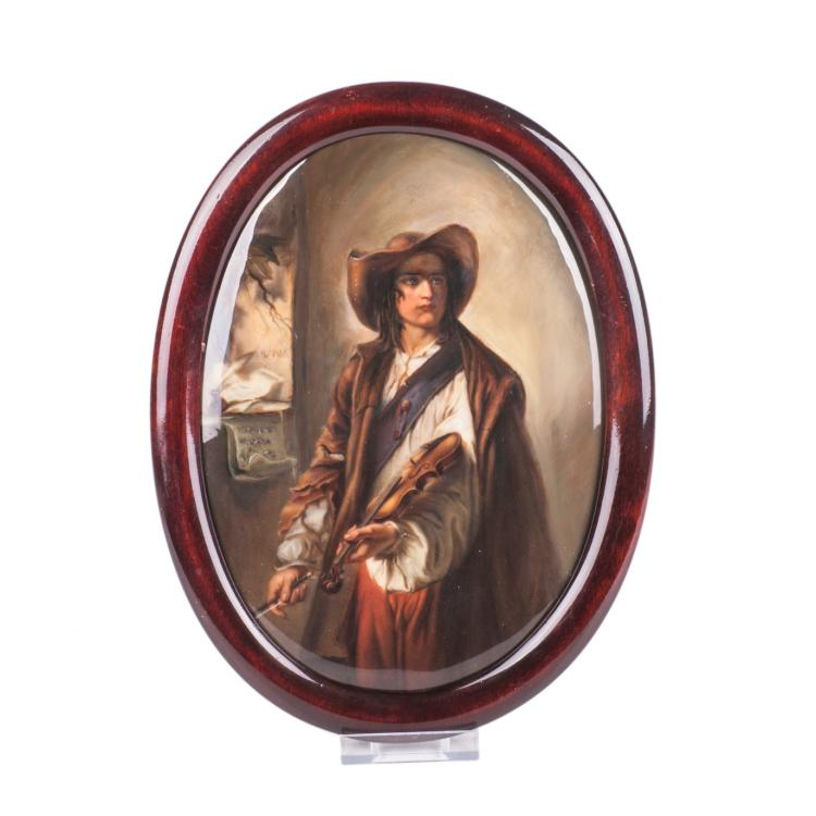 Plaque with a portrait of the violinist in a wooden frame