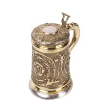 Massive silver-gilt tankard with floral decor