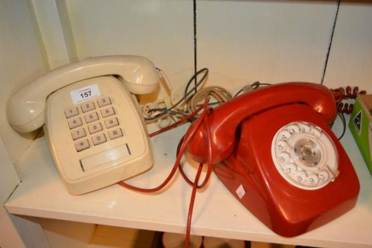 2 vintage telephones incl. a red dial example