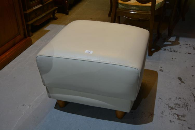 Ivory coloured leather footstool from Freedom