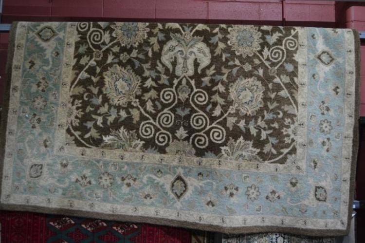 Large machine made woollen rug, floral design in