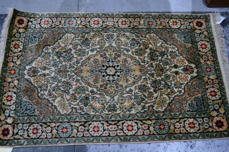 Kashmiri silk hand knotted rug, floral design on