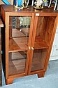 Teak glazed 2-door cabinet with interior shelf