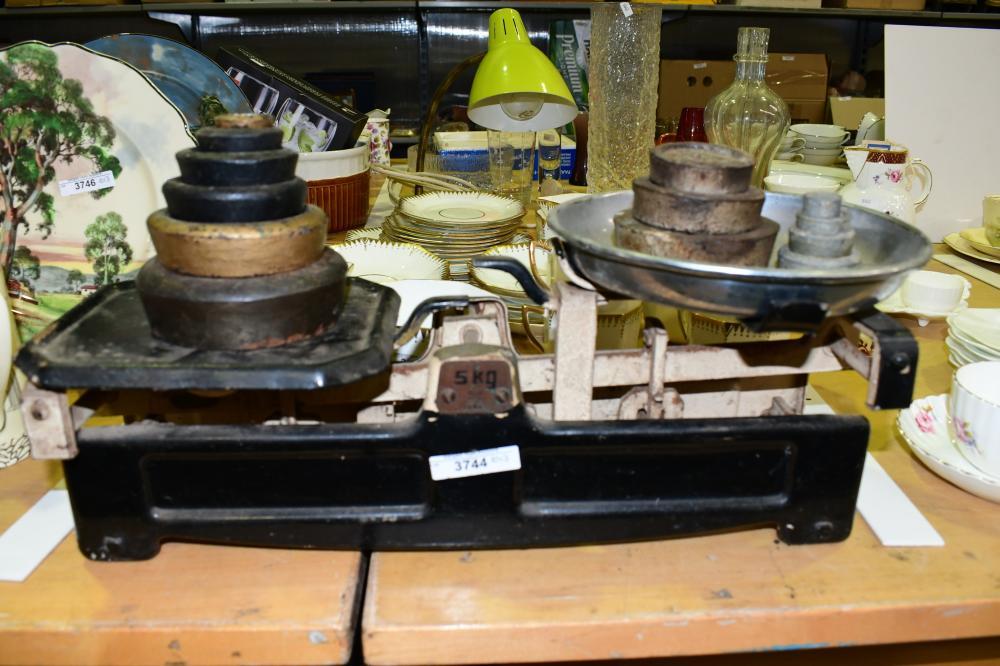 Set of vintage cast iron European balance scales