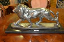 Statue of a prowling lion, silver gilt finish,