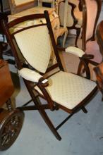Vintage folding wooden sedan style chair,