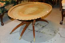 Large hand beaten brass tea table,