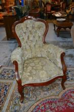 Pair of heavily carved Italian armchairs,