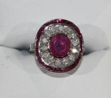 18ct ruby & diamond dress ring, featuring central