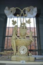 Combination figural lamp, clock and water feature