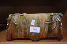Australian pottery trough vase by E. Goodin, in brown, green, glaze with applied gumnut & leaf decoration, signed to underside, 23.5cm W