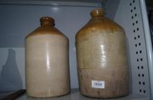 2 pottery demi-johns incl. one from a wine & spirit merchant 1900
