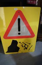 Double sided metal sign, 'Please Follow One Way Arrows' and on the other side is an exclamation 'Danger' sign
