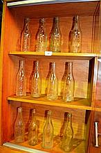 Collection of 16 early glass soft drink bottles