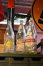 6 x vintage soft drink bottles each with different
