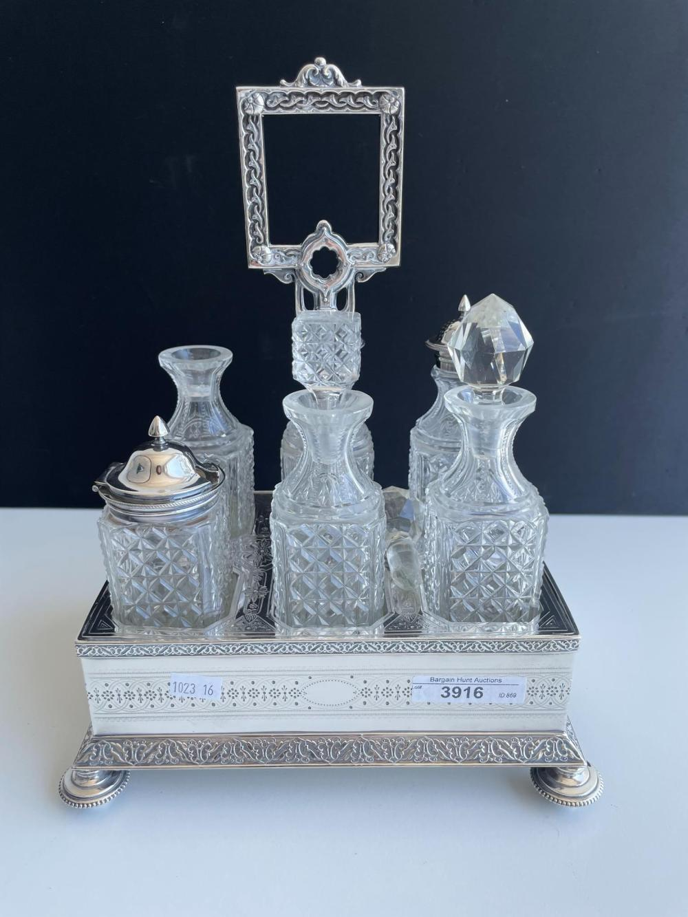 Antique silver plate and glass cruet set, stand 22 cm wide (8.66 in.)