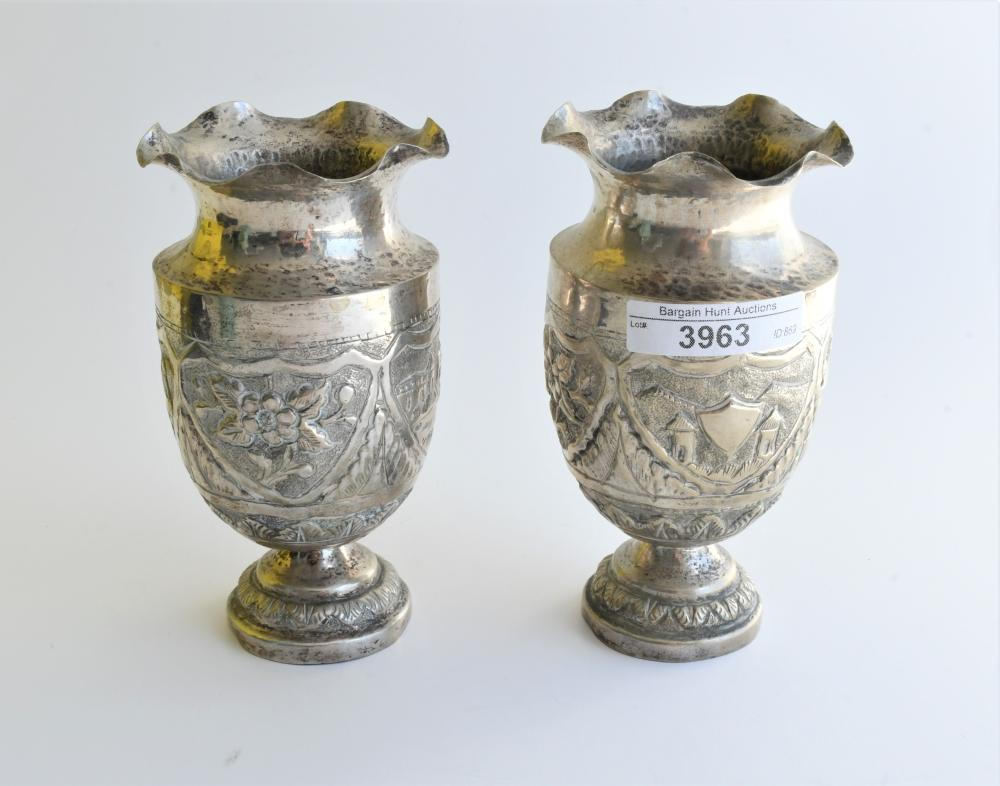 Pair of South East Asian silver vases, 13.50 cm. (5.31 in.)
