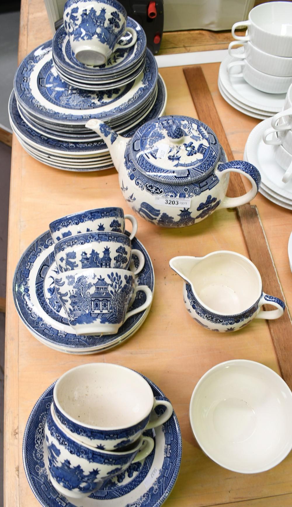 English blue willow dinnerware by Johnson Bros.