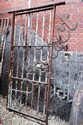 An old wrought iron, hand forged gaol door, with