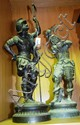 Pair of antique bronzed spelter figurines of