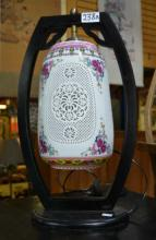Chinese table lamp, ebonised timber frame,