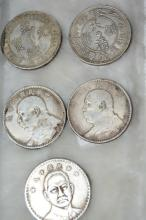 5 silver coloured Chinese coin medallions