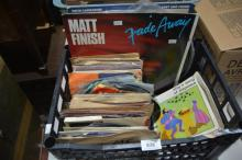 Black crate containing qty of 45s and small